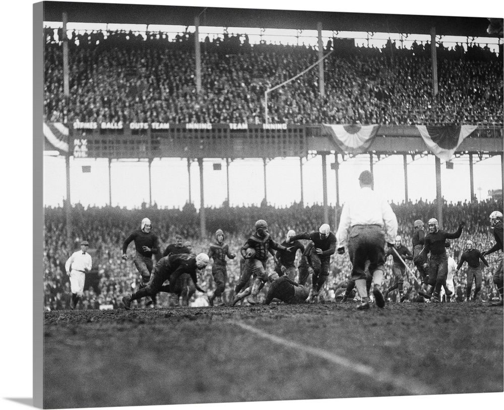 Large Gallery-Wrapped Canvas Wall Art Print 20 x 16 entitled Chicago Bears attempting to gain yards in a game against the ... Gallery-Wrapped Canvas entitled Chicago Bears attempting to gain yards in a game against the New York Giants.  An unidentified player for the Chicago Bears attempting to gain yards in a game against the New York Giants, at the Polo Grounds inNew York City, 6 December 1925.  Multiple sizes available.  Primary colors within this image include Gray, White.  Made in the USA.  Satisfaction guaranteed.  Inks used are latex-based and designed to last.  Canvas is designed to prevent fading.  Museum-quality, artist-grade canvas mounted on sturdy wooden stretcher bars 1.5 thick.  Comes ready to hang.