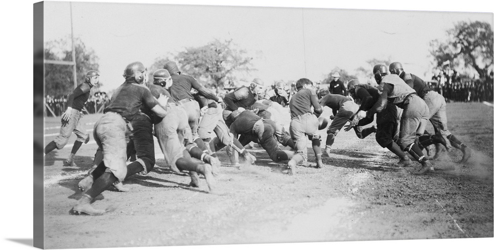 Large Gallery-Wrapped Canvas Wall Art Print 24 x 15 entitled Football Game, c1902 Gallery-Wrapped Canvas entitled Football Game, c1902.  An American football game, c1902.  Multiple sizes available.  Primary colors within this image include Dark Gray, Silver.  Made in the USA.  Satisfaction guaranteed.  Inks used are latex-based and designed to last.  Canvas is designed to prevent fading.  Canvases have a UVB protection built in to protect against fading and moisture and are designed to last for over 100 years.