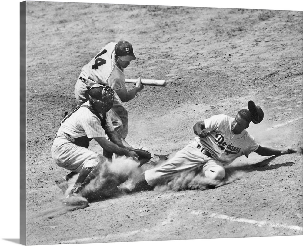 Large Solid-Faced Canvas Print Wall Art Print 30 x 24 entitled Jackie Robinson of the Brooklyn Dodgers Solid-Faced Canvas Print entitled Jackie Robinson of the Brooklyn Dodgers.  John Roosevelt Robinson, known as Jackie. American baseball player. As a member of the Brooklyn Dodgers, stealing home under the tag of catcher Andy Seminick in a game against the Philadelphia Phillies, at Shibe Park, Philadelphia, Pennsylvania, 2 July 1950. The Dodgers batter is Gil Hodges.  Multiple sizes available.  Primary colors within this image include Dark Gray, Silver.  Made in the USA.  Satisfaction guaranteed.  Archival-quality UV-resistant inks.  Archival inks prevent fading and preserve as much fine detail as possible with no over-saturation or color shifting.  Featuring a proprietary design, our canvases produce the tightest corners without any bubbles, ripples, or bumps and will not warp or sag over time.