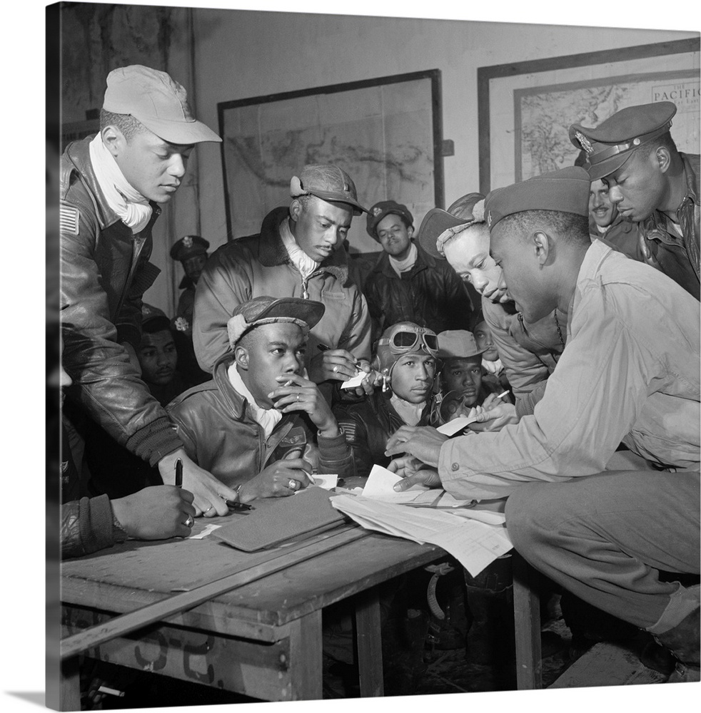 Large Solid-Faced Canvas Print Wall Art Print 20 x 20 entitled Members of the Tuskegee Airmen in a meeting at Ramitelli, I... Solid-Faced Canvas Print entitled Members of the Tuskegee Airmen in a meeting at Ramitelli, Italy, 1945.  Members of the Tuskegee Airmen in a meeting at Ramitelli, Italy. Front row seated, left to right unidentified Jimmie Wheeler with goggles Emile Clifton cloth cap. Standing, left to right Ronald Reeves Hiram Mann Joseph Chineworth Elwood Driver Edward Thomas Woodrow Crockett. Photograph by Toni Frissell, March 1945.  Multiple sizes available.  Primary colors within this image include Dark Gray, Silver.  Made in USA.  Satisfaction guaranteed.  Archival-quality UV-resistant inks.  Archival inks prevent fading and preserve as much fine detail as possible with no over-saturation or color shifting.  Canvas is handcrafted and made-to-order in the United States using high quality artist-grade canvas.
