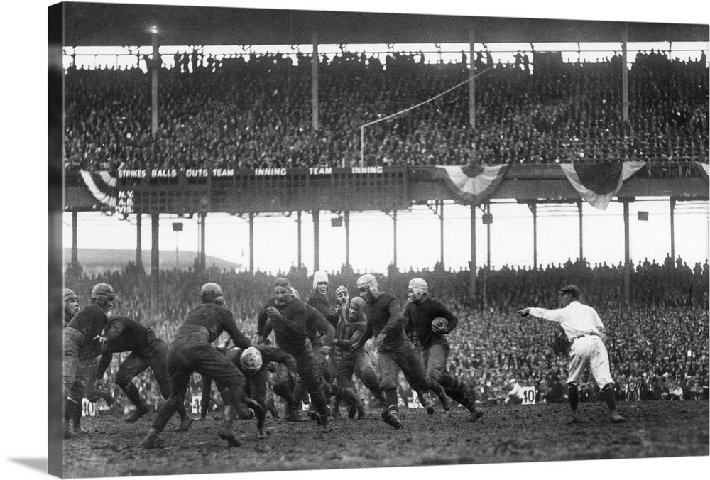 Large Gallery-Wrapped Canvas Wall Art Print 24 x 16 entitled Phil White of the New York Giants in a game against the Chica... Gallery-Wrapped Canvas entitled Phil White of the New York Giants in a game against the Chicago Bears.  Phil White of the New York Giants attempting to gain yards in a game against the Chicago Bears, at the Polo Grounds in New York City, 6 December 1925.  Multiple sizes available.  Primary colors within this image include Dark Gray, White.  Made in USA.  Satisfaction guaranteed.  Inks used are latex-based and designed to last.  Canvases have a UVB protection built in to protect against fading and moisture and are designed to last for over 100 years.  Canvas frames are built with farmed or reclaimed domestic pine or poplar wood.