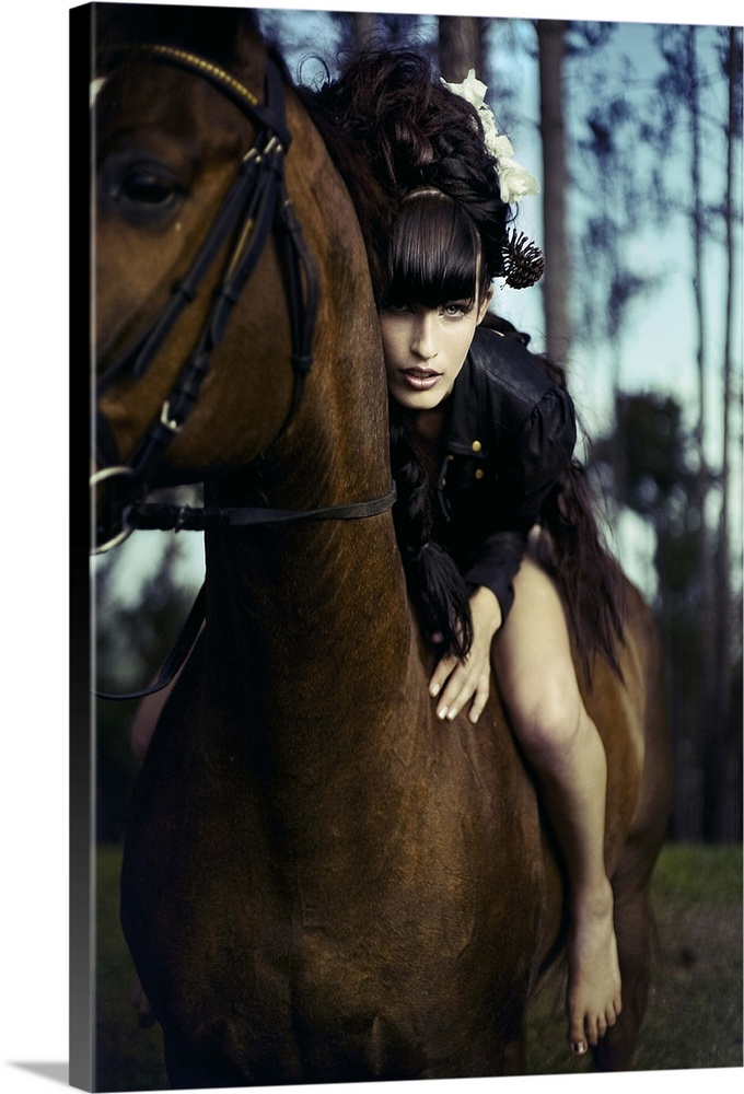 Large Solid-Faced Canvas Print Wall Art Print 20 x 30 entitled Black Forest Solid-Faced Canvas Print entitled Black Forest.  Young woman with black hair sitting bare back on horse leaning forward towards the camera.  Multiple sizes available.  Primary colors within this image include Black, Gray, Light Gray Blue.  Made in USA.  All products come with a 365 day workmanship guarantee.  Archival-quality UV-resistant inks.  Archival inks prevent fading and preserve as much fine detail as possible with no over-saturation or color shifting.  Canvas depth is 1.25 and includes a finished backing with pre-installed hanging hardware.