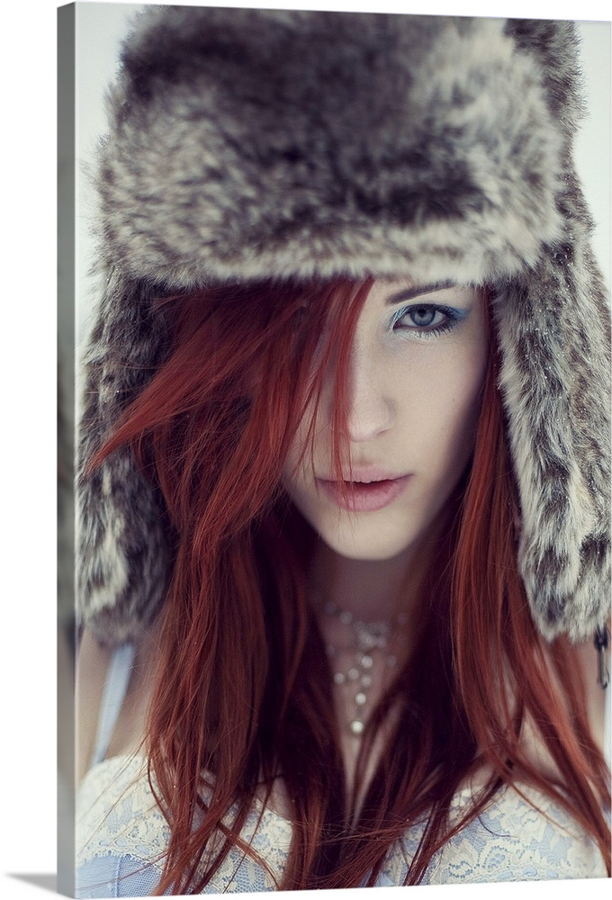 Large Gallery-Wrapped Canvas Wall Art Print 16 x 24 entitled Girl with fur hat looking directly into camera with red hair ... Gallery-Wrapped Canvas entitled Girl with fur hat looking directly into camera with red hair wearing a blue basque.  Multiple sizes available.  Primary colors within this image include Pink Black Light Gray.  Made in the USA.  All products come with a 365 day workmanship guarantee.  Archival-quality UV-resistant inks.  Canvas is a 65 polyester 35 cotton base with two acrylic latex primer basecoats and a semi-gloss inkjet receptive topcoat.  Canvases are stretched across a 1.5 inch thick wooden frame with easy-to-mount hanging hardware.