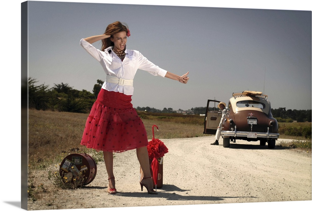Large Gallery-Wrapped Canvas Wall Art Print 24 x 16 entitled The Hitchhiker Gallery-Wrapped Canvas entitled The Hitchhiker.  A model wearing a red skirt thumbing a lift.  Multiple sizes available.  Primary colors within this image include Dark Red Peach Black Gray.  Made in USA.  All products come with a 365 day workmanship guarantee.  Archival-quality UV-resistant inks.  Canvas is a 65 polyester 35 cotton base with two acrylic latex primer basecoats and a semi-gloss inkjet receptive topcoat.  Canvases are stretched across a 1.5 inch thick wooden frame with easy-to-mount hanging hardware.