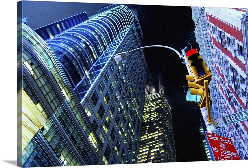 Large Solid-Faced Canvas Print Wall Art Print 30 x 20 entitled Times Square, Manhattan, New York City Solid-Faced Canvas Print entitled Times Square, Manhattan, New York City.  Buildings on Times Square, Manhattan, New York City, at night.  Multiple sizes available.  Primary colors within this image include Peach, Black, White, Royal Blue.  Made in USA.  Satisfaction guaranteed.  Inks used are latex-based and designed to last.  Canvas is handcrafted and made-to-order in the United States using high quality artist-grade canvas.  Canvas depth is 1.25 and includes a finished backing with pre-installed hanging hardware.