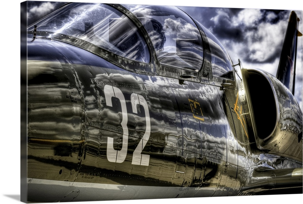 Large Solid-Faced Canvas Print Wall Art Print 36 x 24 entitled Wanna Take A Ride? Solid-Faced Canvas Print entitled Wanna Take A Ride.  Fighter Jet on the tarmac at Central DuPage Airport, Wings of Freedom Tour.  Multiple sizes available.  Primary colors within this image include Black, Light Gray.  Made in the USA.  Satisfaction guaranteed.  Inks used are latex-based and designed to last.  Archival inks prevent fading and preserve as much fine detail as possible with no over-saturation or color shifting.  Featuring a proprietary design, our canvases produce the tightest corners without any bubbles, ripples, or bumps and will not warp or sag over time.