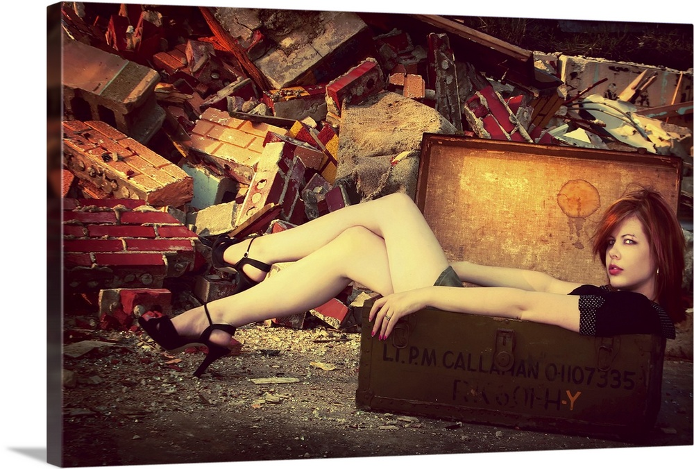 Large Gallery-Wrapped Canvas Wall Art Print 24 x 15 entitled Wonder Full Gallery-Wrapped Canvas entitled Wonder Full.  A young woman wearing a short skirt sitting in a suitcase.  Multiple sizes available.  Primary colors within this image include Red Dark Red Peach Black.  Made in USA.  All products come with a 365 day workmanship guarantee.  Inks used are latex-based and designed to last.  Canvas is a 65 polyester 35 cotton base with two acrylic latex primer basecoats and a semi-gloss inkjet receptive topcoat.  Canvas frames are built with farmed or reclaimed domestic pine or poplar wood.